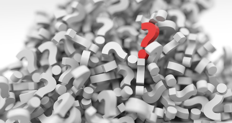 pile of question marks, evoking questions surrounding wrongful dismissal